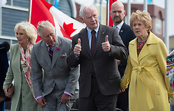 Governor General David Johnston gives the thumbs up as before sitting down with Prince Charles, Camilla and Sharon Johnston at the start of the official welcome in Iqaluit, Nunavut, Canada, Thursday, June 29, 2017. Photo by Adrian Wyld/ABACAPRESS.COM