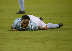 August 4, 2018 - Houston, TX, U.S. - HOUSTON, TX - AUGUST 04:  Sporting Kansas City forward Gerso (12) winces with pain after tangling with Houston Dynamo forward Romell Quioto (31) during the soccer match between Sporting Kansas City and Houston Dynamo on August 4, 2018 at BBVA Compass Stadium in Houston, Texas.  (Photo by Leslie Plaza Johnson/Icon Sportswire) (Credit Image: © Leslie Plaza Johnson/Icon SMI via ZUMA Press)