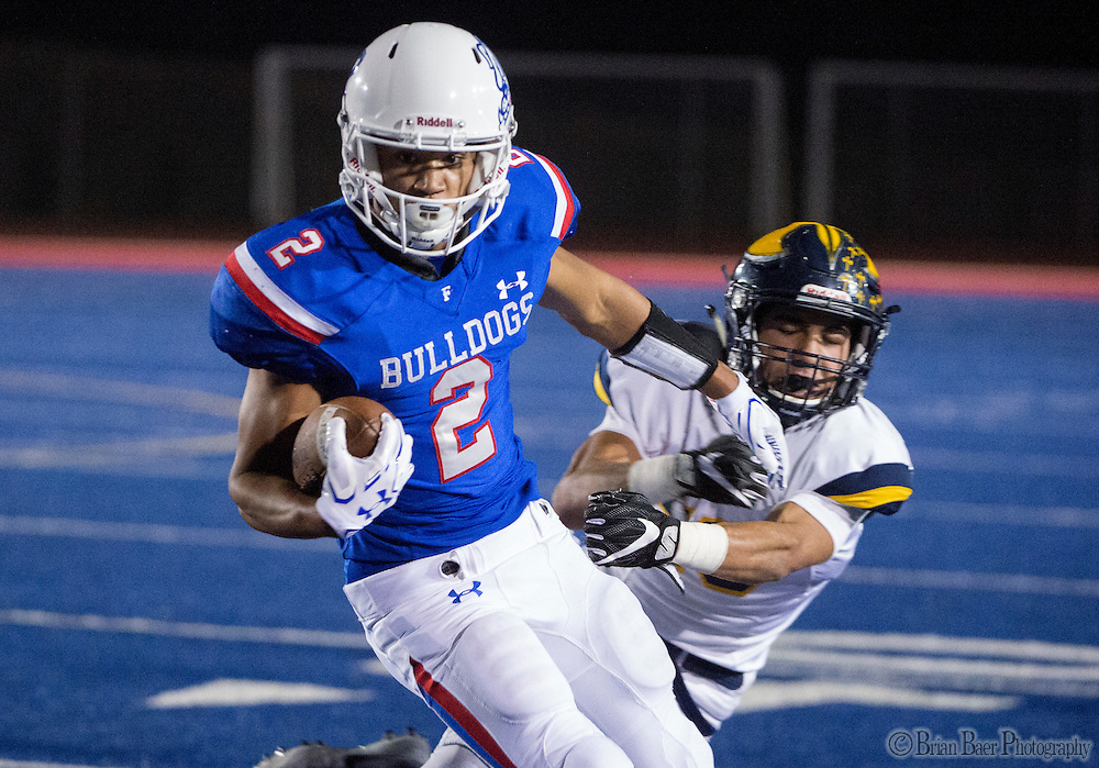 Oak Ridge Trojans Justin Poerio (19), tackles Folsom High School Bulldogs Drake Stallworth (2), as he runs with the ball during the second quarter as the Folsom High School Bulldogs varsity football team host the Oak Ridge High School Trojans,  Friday Nov 4, 2016.<br /> photo by Brian Baer