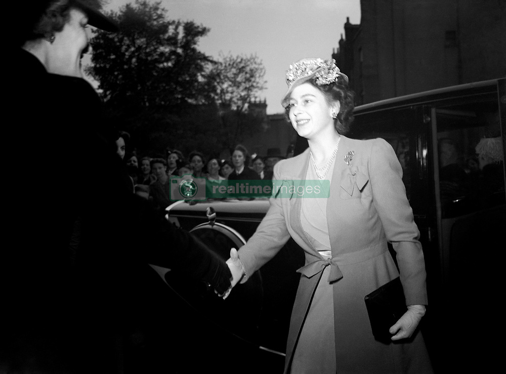 """Embargoed to 2100 Friday May 08 File photo dated 25/05/46 of Queen Elizabeth II, then Princess Elizabeth, arriving at the Fourth Birthday Rally of the Girls' Training Corps, at the Royal Albert Hall. As the Queen spoke of the jubilant celebrations which """"some of us experienced first-hand"""", she was no doubt thinking back to her own VE Day adventures."""