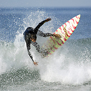 SURFERS-  Joe Turpel surfs near Santa Barbara.  PHOTO:  ©Todd Bigelow Model Released