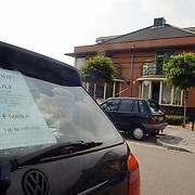 Gemeente tegen verkoop auto's Gemeenlandslaan Huizen, te koop