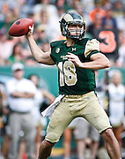 SHOT 9/1/13 4:30:04 PM - Colorado State quarterback Garrett Grayson #18 drops back to pass while playing against Colorado during the 2013 Rocky Mountain Showdown at Sports Authority Field at MiIe HIgh Stadium in Denver, Co. Colorado won the annual in-state rivalry 41-27. (Photo by Marc Piscotty / © 2013)