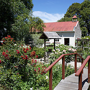 The Cobblestones Regional Early Settlers Museum,  Greytown. New Zealand...The Cobblestones Regional Early Settlers Museum is located in Greytown on the original site of the stables operated by Cobb & Co and the Hastwells to provide a mail and passenger service between Wellington and the Wairarapa from 1866.  The Museum's name comes from the well-preserved cobblestone courtyard at the entrance and inside the Hastwell Stables...Historic Wairarapa buildings relocated to the Museum include a Colonial Cottage (Greytown c.1867), Wairarapa's first Public Hospital, (Greytown 1875), Wairarapa's first Methodist church (Greytown 1865), the Donald Woolshed (1858) and the single-teacher Mangapakeha country school which opened in 1902...The museum site also features a display of horse-drawn vehicles, gigs and tradesmen's vehicles including the 'Pride of the Valley' Cobb & Co Coach built in 1906 and used twice a day as the Martinborough to Featherston railway link until 1919 when motorbuses replaced it. In addition the Museum features a fire station, a vintage machinery building and a blacksmith's forge...The Printing Works with its vintage printing presses is housed in a former store from Main Street, Greytown. 2nd January 2011. Photo Tim Clayton