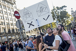October 3, 2017 - Barcelona, Spain - Hundreds of pro-independence activist demonstrate during the gereal strike against the spanish police attack to the Catalonia's referendum on October 1, in Barcelona on october 3, 2017. (Credit Image: © Miquel Llop/NurPhoto via ZUMA Press)