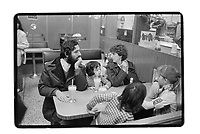 Family in a greasy caf in South East London, 1982. South-East London, 1982
