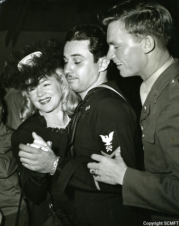 1942 Claire Trevor dances with servicemen during the opening ceremonies of the Hollywood Canteen