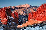 The colorful rocks of Garden of the Gods park frame Pikes Peak 14,110ft, Colorado Springs, Colorado.