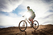 SHOT 10/14/16 4:05:36 PM - Mike Tryggestad of Denver, Co. bikes down Murphy's Hogback on the White Rim Trail. The White Rim is a mountain biking trip in Canyonlands National Park just outside of Moab, Utah. The White Rim Road is a 71.2-mile-long unpaved four-wheel drive road that traverses the top of the White Rim Sandstone formation below the Island in the Sky mesa of Canyonlands National Park in southern Utah in the United States. The road was constructed in the 1950s by the Atomic Energy Commission to provide access for individual prospectors intent on mining uranium deposits for use in nuclear weapons production during the Cold War. Four-wheel drive vehicles and mountain bikes are the most common modes of transport though horseback riding and hiking are also permitted.<br /> (Photo by Marc Piscotty / © 2016)