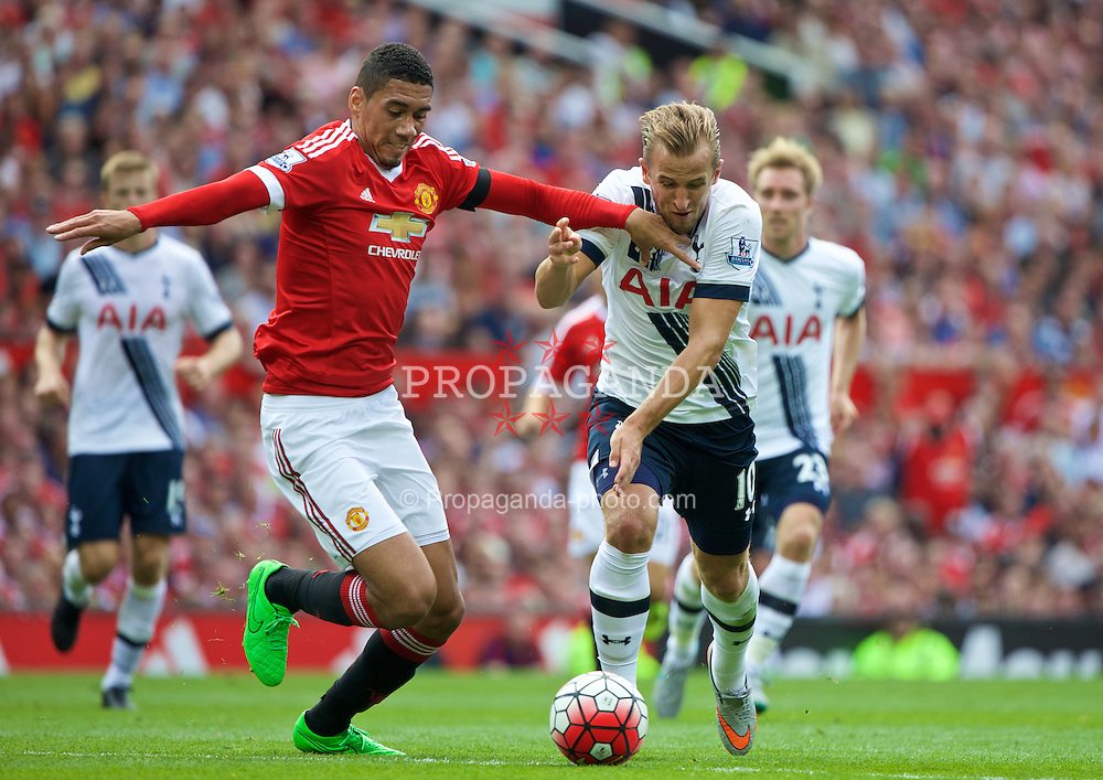 MANCHESTER, ENGLAND - Saturday, August 8, 2015: Manchester United's Chris Smalling in action against Tottenham Hotspur's Harry Kane during the Premier League match at Old Trafford. (Pic by David Rawcliffe/Propaganda)