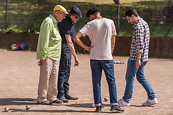 """© Licensed to London News Pictures. 05/06/2015.   London, UK. Jim Beach (left), manager of the rock band, Queen, and Monty Python star, Eric Idle (second left), take part in """"Freddie for the Day"""", by playing a special game of celebrity Pétanque, competing for the Londonaise 'Celebrity Pétanque Trophy', ahead of The Londonaise Pétanque festival this weekend in Barnard Park, Islington.  The festival will set a new precedent in the UK with 128 teams taking part in the main tournament.  The event also aims to raise funds for the Mercury Phoenix Trust to fight against AIDS worldwide. Photo credit : Stephen Chung/LNP"""