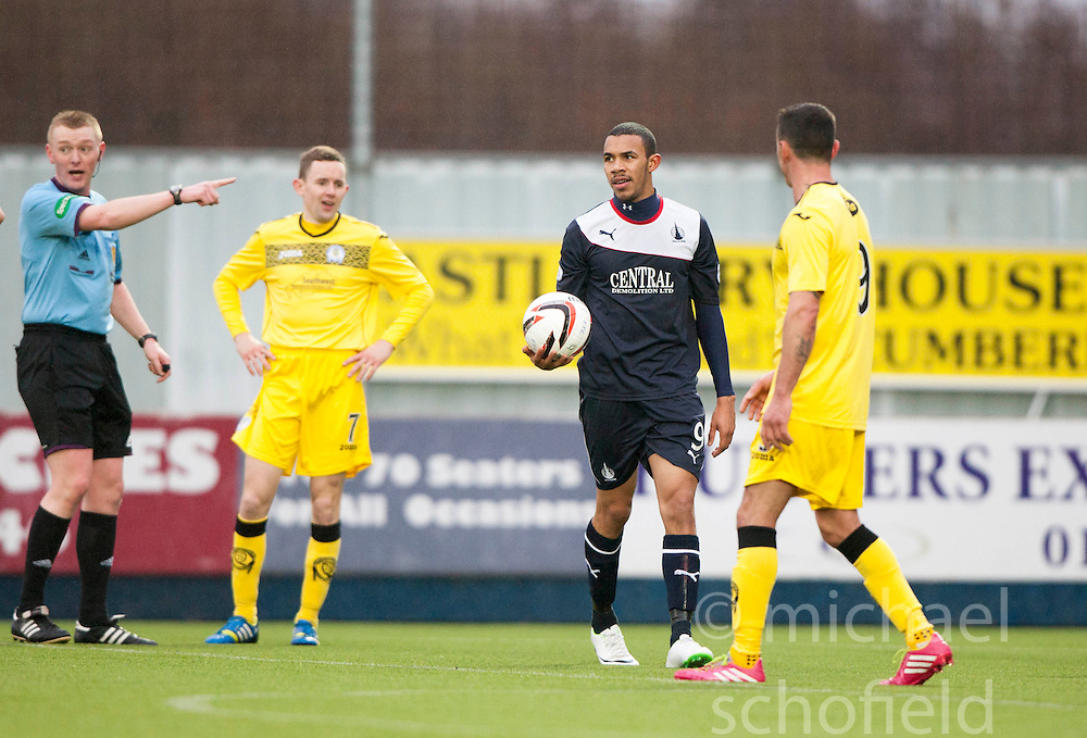 Ref Brian Colvin points to the penalty spot.<br /> Falkirk 1 v 0 Queen of the South, Scottish Championship game today at the Falkirk Stadium.<br /> © Michael Schofield.