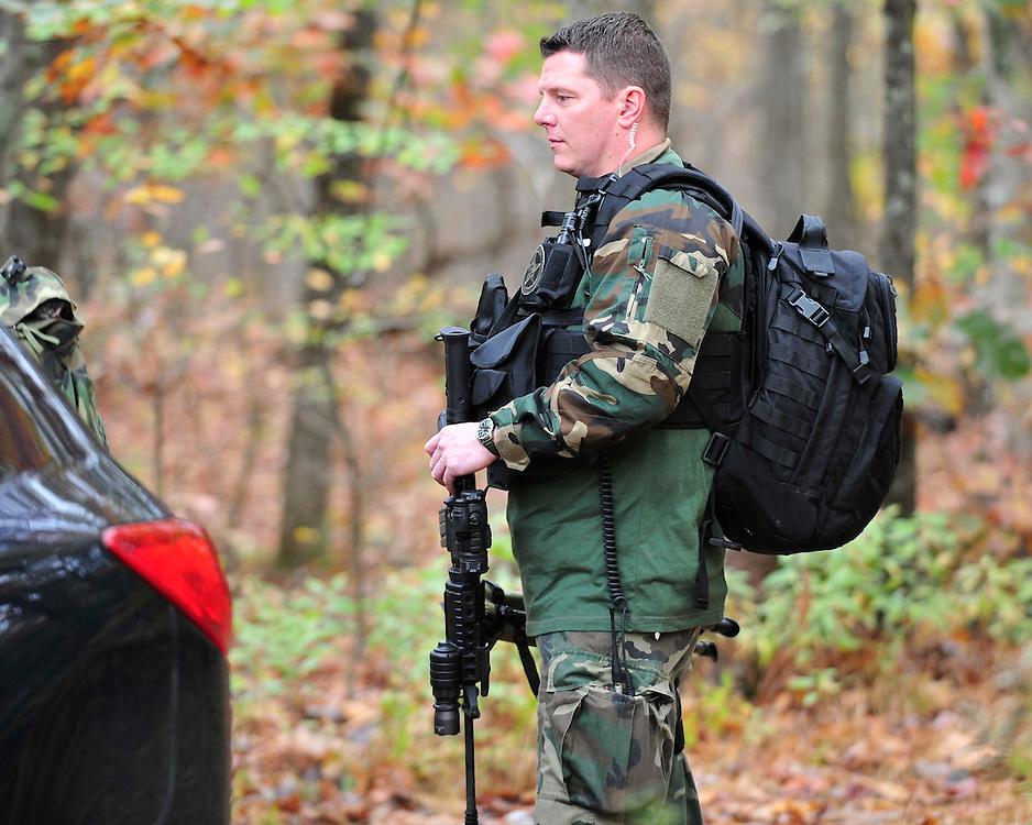Police and federal agents continue to comb the Pocono Mountains in search of alleged cop killer Eric Matthew Frein Oct. 22, 2014, near Henryville, Pa. (Chris Post | lehighvalleylive.com)
