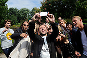 Perspresentatie Expeditie Robinson 2014 op het Westergasterrein, Amsterdam<br /> <br /> Op de foto:  Rapper Mr. Polska maakt een selfie met Rick Brandsteder, Nicolette Kluijver, Manuel Broekman, Lone van Roosendaal, Kay Nambiar, Anouk Maas, Freddy Tratlehner, Leo Alkemade, Dennis Weening, Remy Bonjasky, Ancilla Tilia, Loek Peters, Krystl, Coosje Smid, Juliette van Ardenne, Lobke Berkhout, Sabrina Starke, Ferry Doedens en Nadia Pelesa Poeschmann.