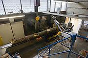 Een zaagmachine zaagt de bomen tot stronken. Produktie bij de grootste klompenfabriek ter wereld, Klompenfabriek Nijhuis B.V. in Beltrum. Voor de productie van klompen worden speciale en zelf ontwikkelde machines gebruikt. Hoewel het principe al erg oud is, worden de productietechnieken nog steeds verbeterd.<br /> <br /> A big machine is sawing the trees in stumps. Production at the biggest manufacturer of wooden shoes, Klompenfabriek Nijhuis B.V. at Beltrum (NL). For the production special and self developed machines are used. Although the principe of the manufacturing is very old, the techniques are still being improved.
