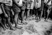 Feet. School boys, Uganda.