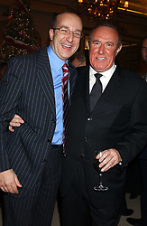 Left to right, PAUL McKENNA and ANDREW NEIL at The Business Winter Party hosted by Andrew Neil at The Ritz Hotel, Piccadilly, London on 7th December 2005.<br /><br />NON EXCLUSIVE - WORLD RIGHTS