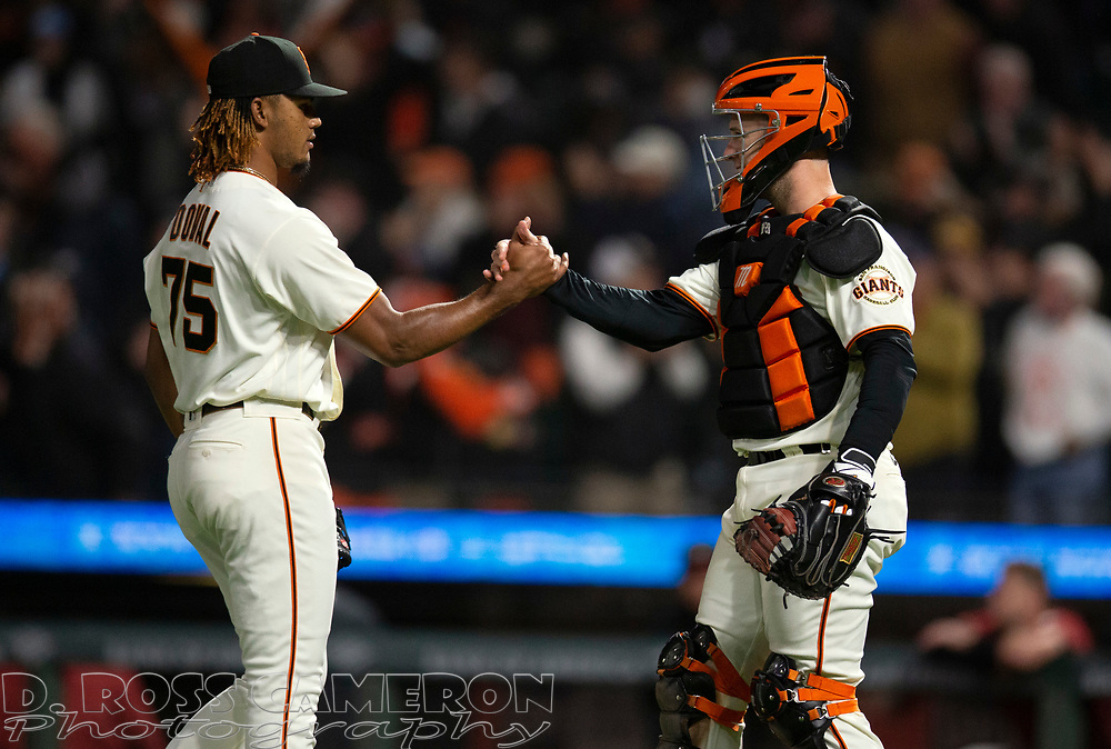 Sep 29, 2021; San Francisco, California, USA; San Francisco Giants pitcher Camilo Doval (75) and catcher Buster Posey celebrate their 1-0 victory over the Arizona Diamondbacks at Oracle Park. Mandatory Credit: D. Ross Cameron-USA TODAY Sports