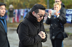 Aiyawatt Srivaddhanaprabha views floral tributes for those who lost their lives in the Leicester City helicopter crach including Leicester City Chairman Vichai Srivaddhanaprabha ahead of the Premier League match at the King Power Stadium, Leicester.