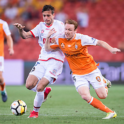 BRISBANE, AUSTRALIA - OCTOBER 13: Nikola Mileusnic of Adelaide and Corey Brown of the Roar compete for the ball during the Round 2 Hyundai A-League match between Brisbane Roar and Adelaide United on October 13, 2017 in Brisbane, Australia. (Photo by Patrick Kearney)