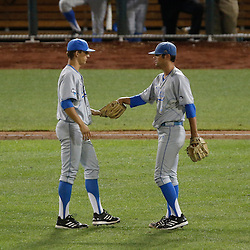 Jun 24, 2013; Omaha, NE, USA; UCLA Bruins starting pitcher Adam Plutko (right) gives the baseball to pitcher James Kaprielian (left) in a pitching change during the seventh inning in game 1 of the College World Series finals against the Mississippi State Bulldogs at TD Ameritrade Park. Mandatory Credit: Derick E. Hingle-USA TODAY Sports