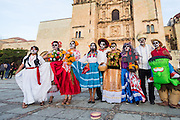 A group of teenagers wearing skeleton face paint pose in costume during the Day of the Dead Festival known in spanish as Día de Muertos October 30, 2014 in Oaxaca, Mexico.