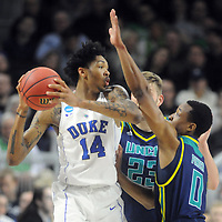 UNCW's C.J. Gettys and Craig Ponder keep the pressure on Duke's Brandon Ingram in the Seahawks 93-85 loss in the NCAA Tournament at the Dunkin Donuts Center in Providence, R.I. on Thursday. StarNews/Mike Spencer