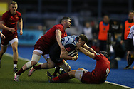 Owen Lane of Cardiff Blues is tackled by Sammy Arnold  (l) and Duncan Williams ® of Munster rugby.  Guinness Pro14 rugby match, Cardiff Blues v Munster Rugby at the Cardiff Arms Park in Cardiff, South Wales on Saturday 17th February 2018.<br /> pic by Andrew Orchard, Andrew Orchard sports photography.