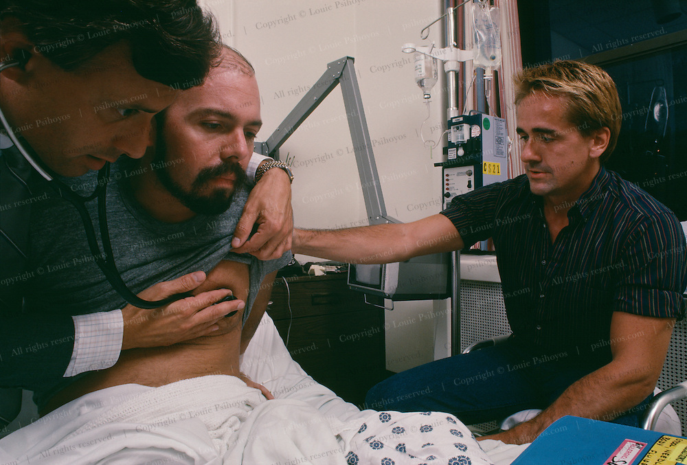 AIDS patient Barrett Brown with lover Dennis in Cabrini Hospital, New York City, 1985. Also pictured is Dr. S. Caiazza.