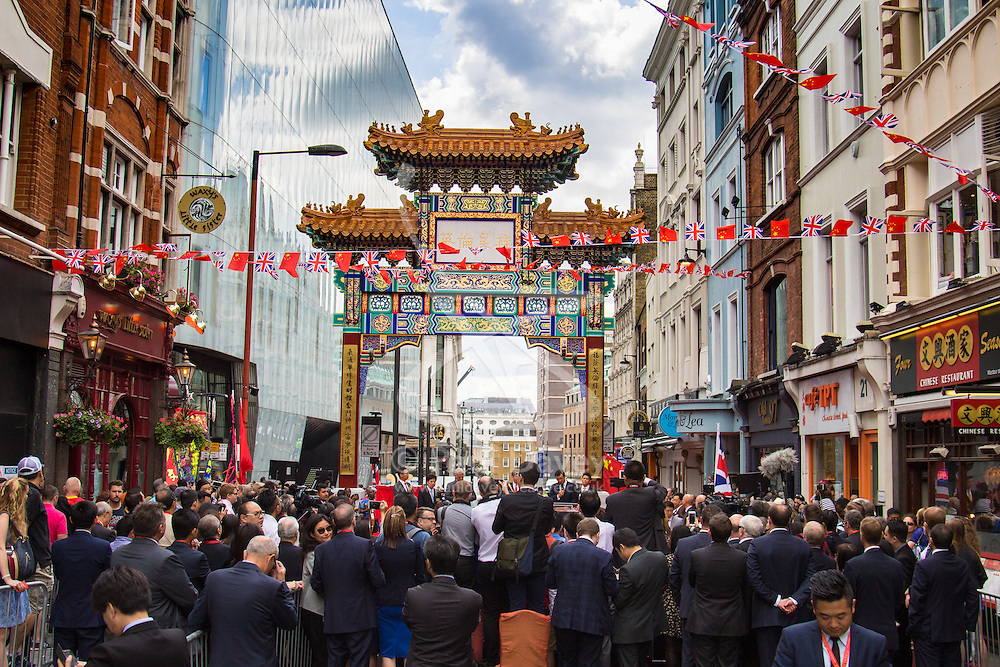 Chinatown, London, July 25thy 2016. His Royal Highness Prince Andrew The Duke of York is the Guest of Honour as a new Chinese gate on Wardour Street is inaugurated. The new Chinese gate dwarfs HRH Prince Andrew and the assembled crowds and media.