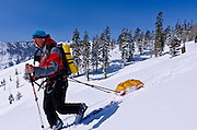 Backcountry skier pulling a sled, Ansel Adams Wilderness, Sierra Nevada Mountains, California USA