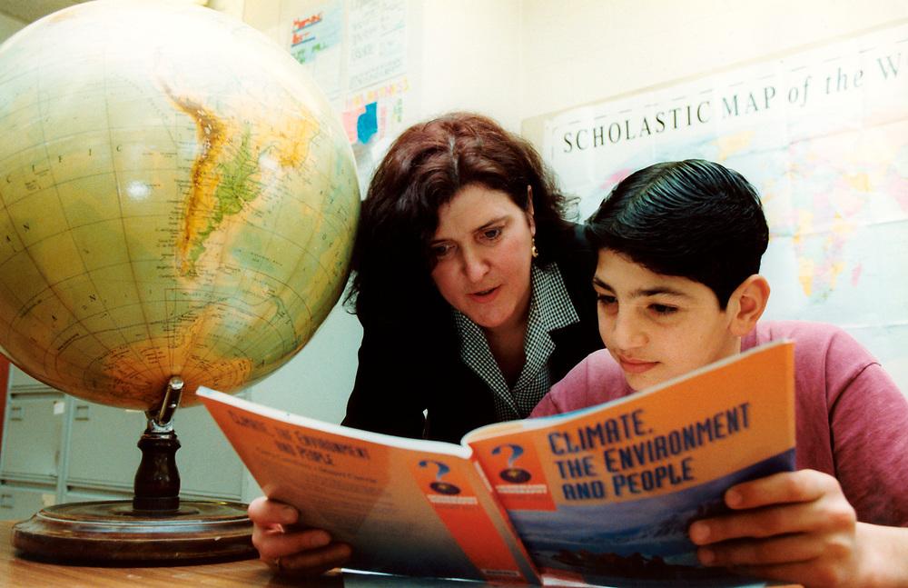 Geography teacher with pupils at Langham secondary school; Tottenham; north London