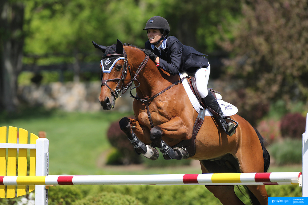 Wesley Newlands riding Lapacco in action during the $100,000 Empire State Grand Prix presented by the Kincade Group during the Old Salem Farm Spring Horse Show, North Salem, New York,  USA. 17th May 2015. Photo Tim Clayton