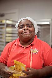 21 September 2015. New Orleans, Louisiana.<br /> Ms Viola Smothers packs Aunt Sally's Pralines.<br /> Photo©; Charlie Varley/varleypix.com