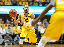 Jan 20, 2018; Morgantown, WV, USA; West Virginia Mountaineers guard Jevon Carter (2) passes the ball during the second half against the Texas Longhorns at WVU Coliseum. Mandatory Credit: Ben Queen-USA TODAY Sports
