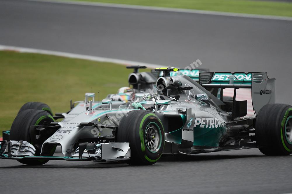 Mercedes drivers Nico Rosberg and Lewis Hamilton in a close fight in the 2014 Japanese Grand Prix in Suzuka. Photo: Grand Prix Photo