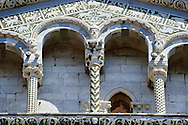 Close up of the Arcades and and columns of St Michele of the 13th century Romanesque facade of the San Michele in Foro,  a Roman Catholic basilica church in Lucca, Tunscany, Italy .<br /> <br /> Visit our ITALY PHOTO COLLECTION for more   photos of Italy to download or buy as prints https://funkystock.photoshelter.com/gallery-collection/2b-Pictures-Images-of-Italy-Photos-of-Italian-Historic-Landmark-Sites/C0000qxA2zGFjd_k<br /> <br /> If you prefer to buy from our ALAMY PHOTO LIBRARY  Collection visit : https://www.alamy.com/portfolio/paul-williams-funkystock/lucca.html .<br /> <br /> Visit our MEDIEVAL PHOTO COLLECTIONS for more   photos  to download or buy as prints https://funkystock.photoshelter.com/gallery-collection/Medieval-Middle-Ages-Historic-Places-Arcaeological-Sites-Pictures-Images-of/C0000B5ZA54_WD0s