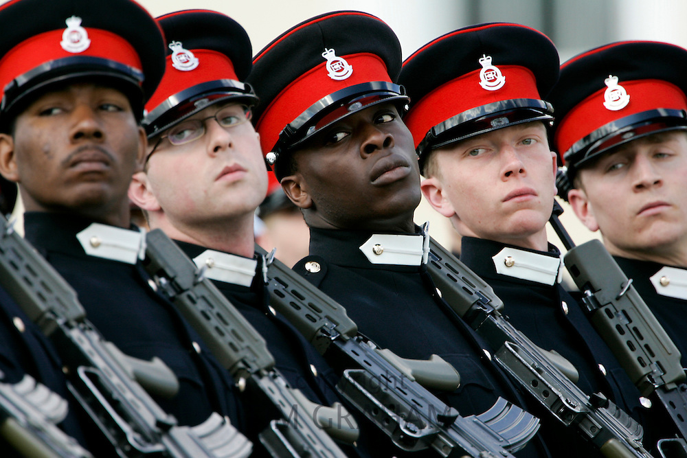 Officer cadets marching at their passing out graduation parade at Sandhurst Military Academy, Surrey