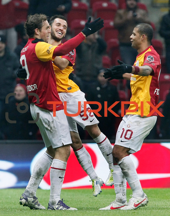 Galatasaray's Johan Elmander (L) celebrate his goal with team mate during their Turkish Super League soccer match Galatasaray between Kardemir Karabukspor at the Turk Telekom Arena at Seyrantepe in Istanbul Turkey on Saturday 14 January 2012. Photo by TURKPIX