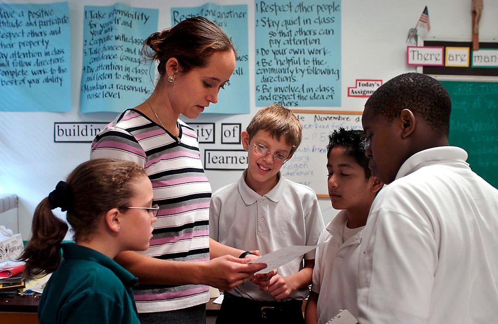 Austin, Texas: Religous instruction at Texas Catholic school classroom, 6th graders.  ©Bob Daemmrich