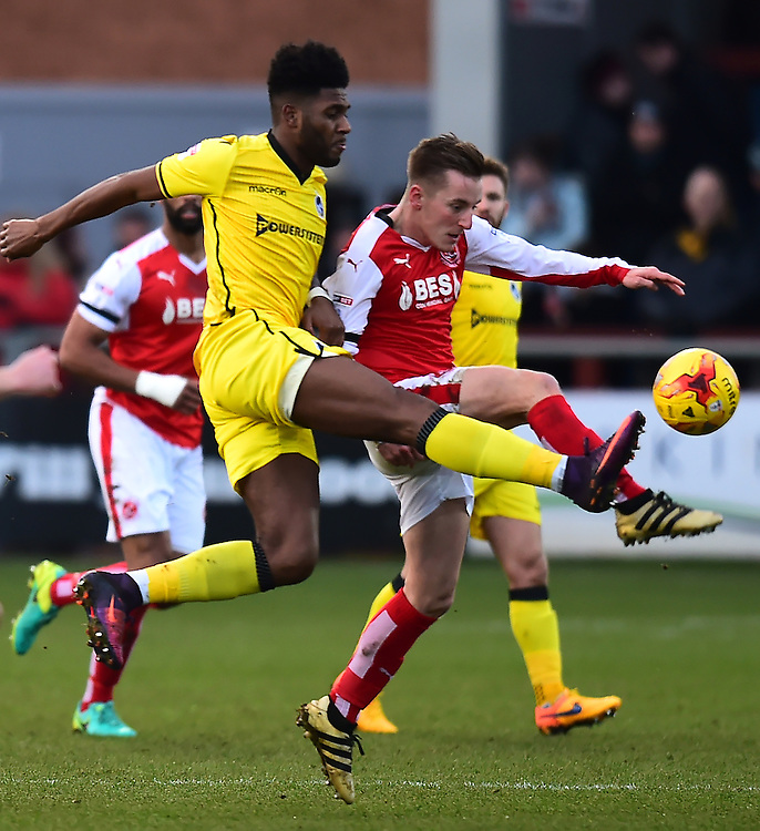 Fleetwood Town's George Glendon vies for possession with Bristol Rovers' Ellis Harrison<br /> <br /> Photographer Richard Martin-Roberts/CameraSport<br /> <br /> The EFL Sky Bet Championship - Fleetwood Town v Bristol Rovers - Saturday 14th January 2017 - Highbury Stadium - Fleetwood<br /> <br /> World Copyright © 2017 CameraSport. All rights reserved. 43 Linden Ave. Countesthorpe. Leicester. England. LE8 5PG - Tel: +44 (0) 116 277 4147 - admin@camerasport.com - www.camerasport.com