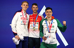 Spain's Alvaro de Arriba (centre), Great Britain's Jamie Webb (left) and Ireland's Mark English with the medals after the Men's 800m Final during day three of the European Indoor Athletics Championships at the Emirates Arena, Glasgow.