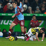 Fenerbahce's Gokhan GONUL (R) and Trabzonspor's Umut BULUT (L) during their Turkish superleague soccer derby match Fenerbahce between Trabzonspor at the Sukru Saracaoglu stadium in Istanbul Turkey on Sunday 30 January 2011. Photo by TURKPIX
