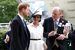 The Duke and Duchess of Sussex prepare to present a trophy during day one of Royal Ascot at Ascot Racecourse.