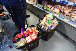 "© Licensed to London News Pictures. 19/12/2014. London, UK. Filled trollies in the Community Shop. The Community Shop opened this week in Gipsy Hill, South London and is a ""social supermarket"", which sells heavily-discounted surplus food that would otherwise be thrown away. Food is received from retail brands such as Marks & Spencer, Asda, Tesco, Innocent and Muller and many more. The shop works on a membership basis only, serving residents who are on income support and aimed at people who are in work, but low waged and for those working hard to find a job. Photo credit : Vickie Flores/LNP"