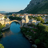 MOSTAR, BOSNIA AND HERZEGOVINA - JUNE 28:  A general view of Mostar and the Old Bridge seen on June 28, 2013 in Mostar, Bosnia and Herzegovina. The Siege of Mostar reached its peak and more cruent time during 1993. Initially, it involved the Croatian Defence Council (HVO) and the 4th Corps of the ARBiH fighting against the Yugoslav People's Army (JNA) later Croats and Muslim Bosnian began to fight amongst each other, it ended with Bosnia and Herzegovina declaring independence from Yugoslavia.  (Photo by Marco Secchi/Getty Images)