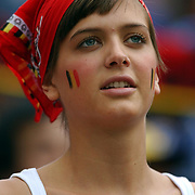 A Belgium fan looks forward to the match