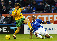 Photo: Chris Ratcliffe.<br />Leicester City v Norwich City. Coca Cola Championship. 31/12/2005.<br />Dion Dublin (R) clears as Paul McVeigh of Norwich closes him down.
