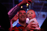 CUTENESS OVERLOAD Daryl Gurney and his baby boy take a selfie with a fan after his Second Round victory against Ross Smith during the Darts World Championship 2018 at Alexandra Palace, London, United Kingdom on 18 December 2018.