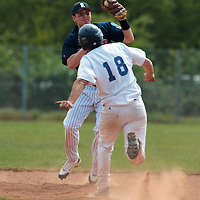 25 April 2010: Aaron Hornostaj of Rouen makes a double play during game 1/week 3 of the French Elite season won 12-4 by Rouen over the PUC, at the Pershing Stadium in Vincennes, near Paris, France.